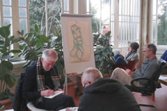 Students drawing in the school veranda